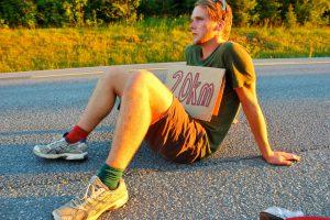 Jamie hitchhiking.