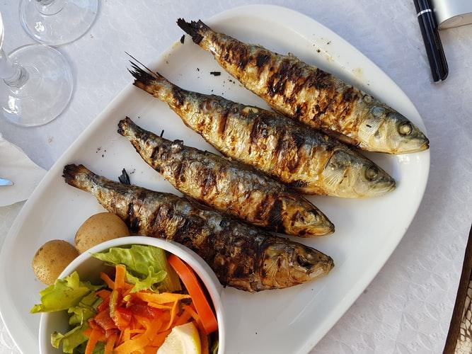 Sardinhas asadas, Portuguese Food, Portuguese cuisine, traditional Portuguese food, food in Portugal, Portuguese dishes